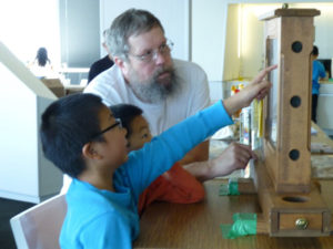 Microsoft employee and PSBA Vice President Mark Hohn chats w/ kids about bees at fundraising event 2013.