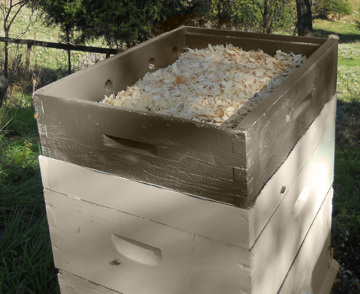 Moisture Quilt on Langstroth Hive filled with cedar shavings